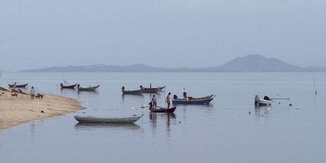 Fishermen on the coast of Pha Ngan, Thailand